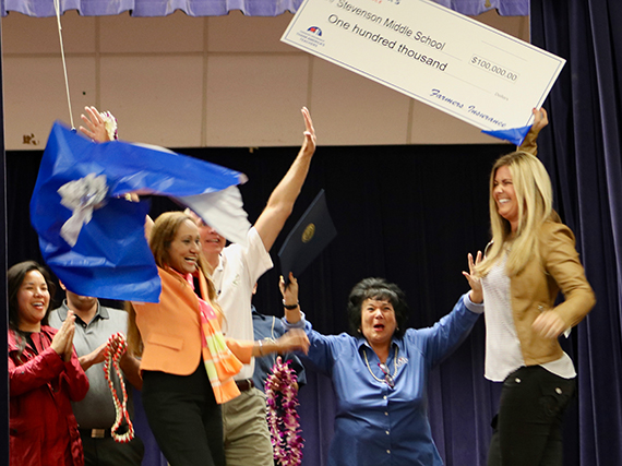 Photo of the surprise award during a school-wide assembly.