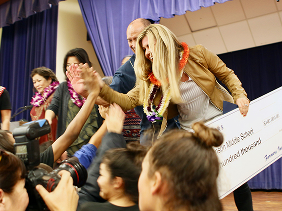 Photo of STEM teacher Patricia Morgan receiving high-fives from Stevenson Middle students.