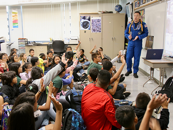 Astronaut speaks to students