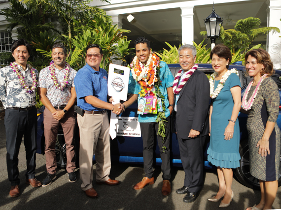 Photo of 2019 Hawaii State Teacher of the Year Mathieu Williams' in front of a prize free leased vehicle.