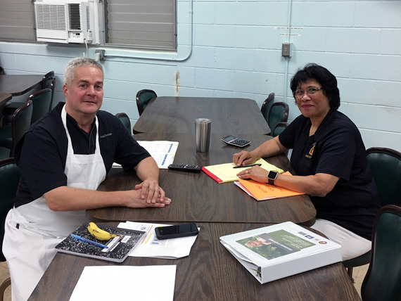 Chef Greg Christian meets with Mililani High's Cafeteria Manager Debra Kam.