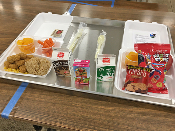 Photo of a school lunch and breakfast meals.