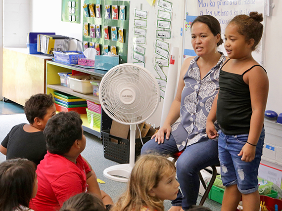 Photo of teacher during Hawaiian immersion lessons with students.