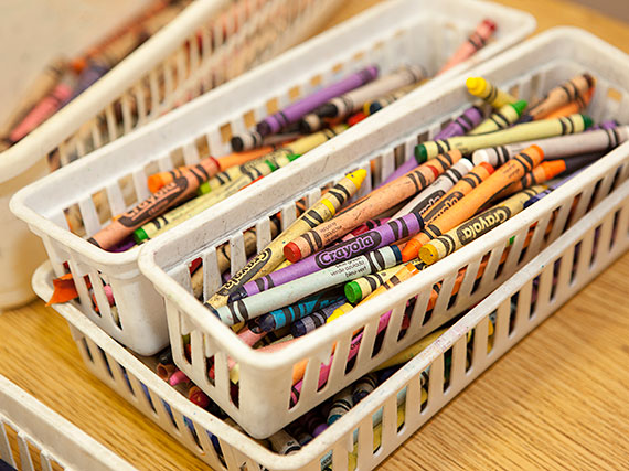 Photo of crayon basket on a desk.