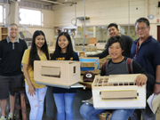 Farrington students with winning designs.