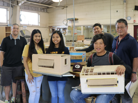 Farrington students work on their trailer project for the World Surf League.