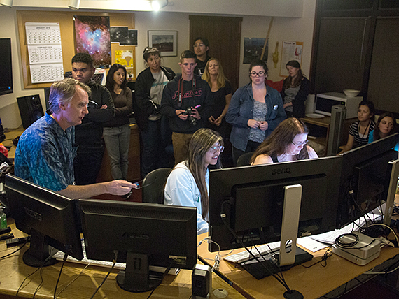 Maunakea Scholars using CFH-Telescope to research the universe.