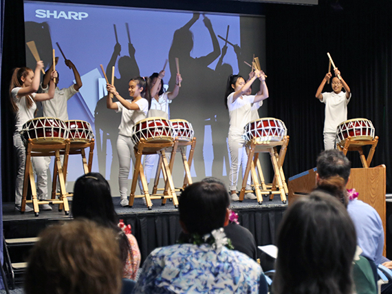 Photo of Moanalua High students performing on Korean Nanta drums donated by the Korean Consulate.